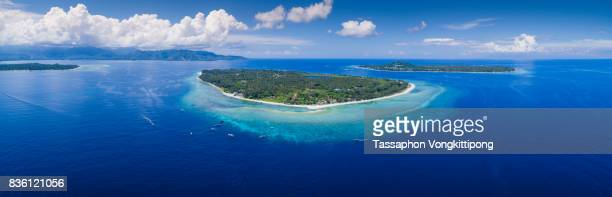 panoramic aerial view of gili trawangan island with clear blue sky in lombok, indonesia - gili trawangan stock photos and pictures