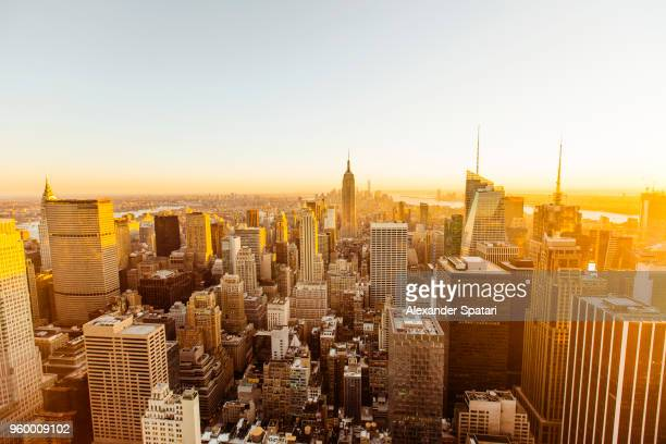 panoramic aerial view of manhattan skyline during sunset, new york city, usa - wide angle stock pictures, royalty-free photos & images