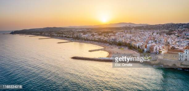 panoramic aerial view of sitges at sunset. catalonia. spain - barcelona spain stock pictures, royalty-free photos & images