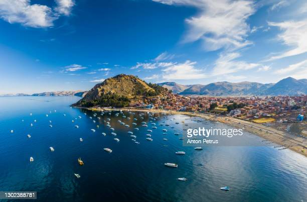 panoramic aerial view of titicaca lake and copacabana city. bolivia - copacabana stock pictures, royalty-free photos & images
