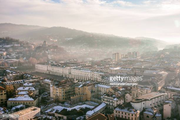 panoramic aerial view of turin and snowy italian alps - turin stock pictures, royalty-free photos & images