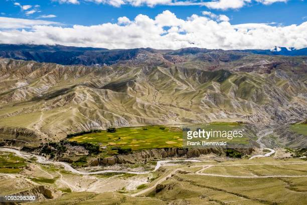 Panoramic aerial view on buckwheat and barley fields and the barren landscape of Upper Mustang.