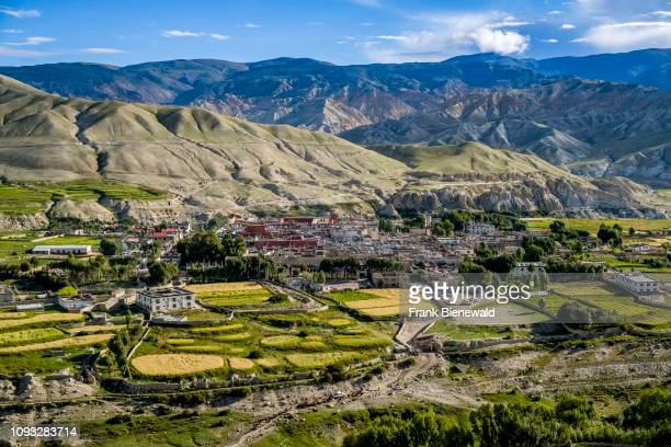 Panoramic aerial view on the town, the agricultural surroundings and the barren landscape of Upper Mustang.