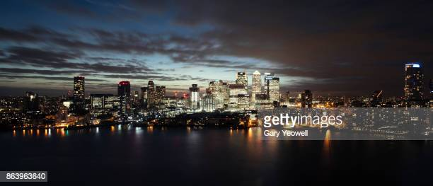 Panoramic aerial view over London Canary Wharf at night