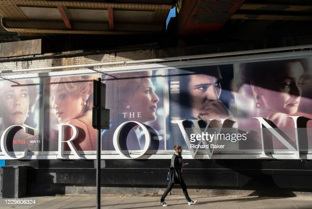 Panoramic billboard advertising the latest series of Netflix's 'The Crown' which is now airing on demand, shows the main characters of the British...
