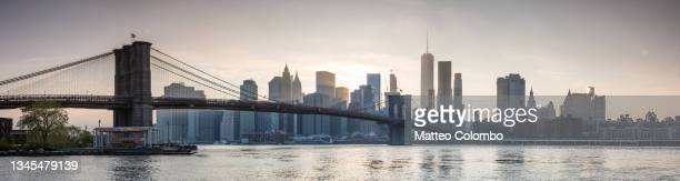 panoramic: brooklyn bridge and manhattan at sunset, new york city - brooklyn new york stock pictures, royalty-free photos & images