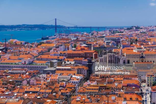 Panoramic capital view of Carmo Convent, Santa Justa Lift and Ponte 25 de Abril bridge, Lisbon, Portugal, Europe