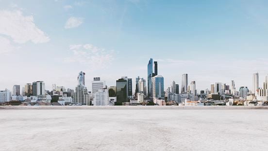 Panoramic city view with empty concrete floor 693903950