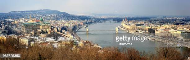 panoramic cityscape of budapest with snowy winter landscape at day - royal palace budapest stock pictures, royalty-free photos & images