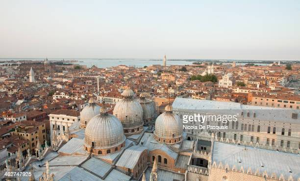 CONTENT] Panoramic cityscape of Venice taken from the tower of St Mark Basilica showing the roof of the Cathedral and some buildings July 15 2013