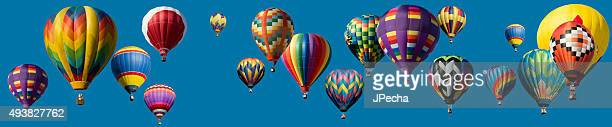 panoramic composite hot air balloons flying over blue clear sky - hot air balloon stock pictures, royalty-free photos & images