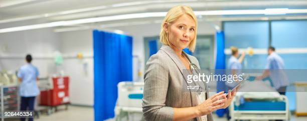 panoramic doctor portrait - sturti stock pictures, royalty-free photos & images