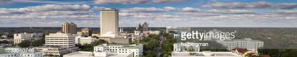 panoramic drone shot of florida state capitol complex in tallahassee - tallahassee stock pictures, royalty-free photos & images