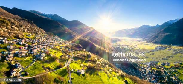 panoramic elevated view of the alpine village and valtellina valley in spring - italia ストックフォトと画像