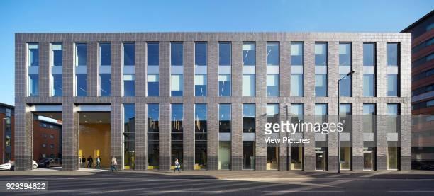 Panoramic elevation of four-storey building. MMU Student Union, Manchester, United Kingdom. Architect: Feilden Clegg Bradley Studios LLP, 2015.