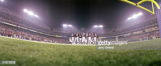 Panoramic floor view from the end zone as the Baltimore Ravens huddle during a preseason game against the Atlanta Falcons at MT Stadium on August 12...