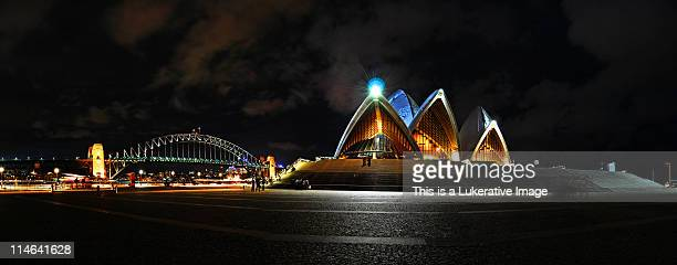 panoramic from bridge to opera house - opera house stock pictures, royalty-free photos & images
