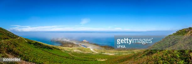 panoramic image of fort clonque in the morning fog, alderney, guernsey, channel islands - english channel stock photos and pictures