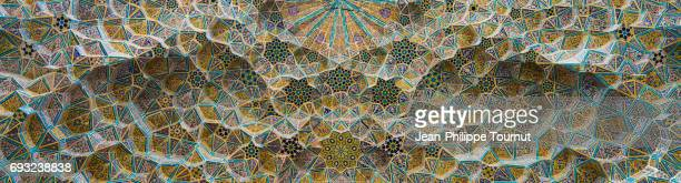 Panoramic image of painted tiles mosaic on the ceiling of a mosque entrance vault in Shiraz, Fars Province, Iran