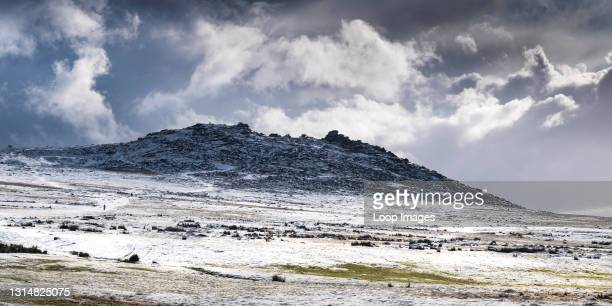 Panoramic image of snow on the wild rugged Rough Tor on Bodmin Moor in Cornwall.