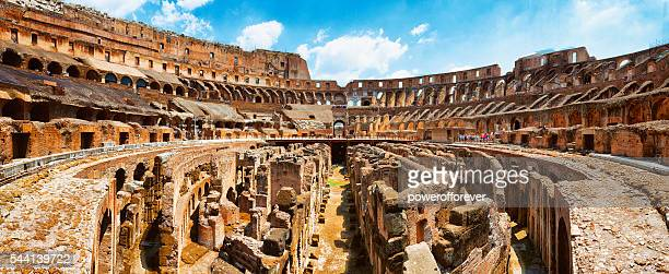 panoramic interior of the colosseum in rome, italy - inside the roman colosseum stock photos and pictures