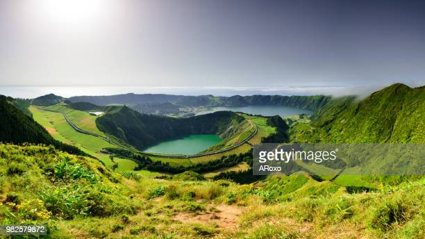panoramic landscape from azores lagoons. sland of sao miguel has many lakes - vulkan stock-fotos und bilder