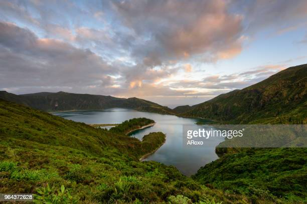 panoramic landscape from azores lagoons. the azores archipelago has volcanic origin and the island of são miguel has many lakes formed in craters of ancient volcanoes - azores stock photos and pictures