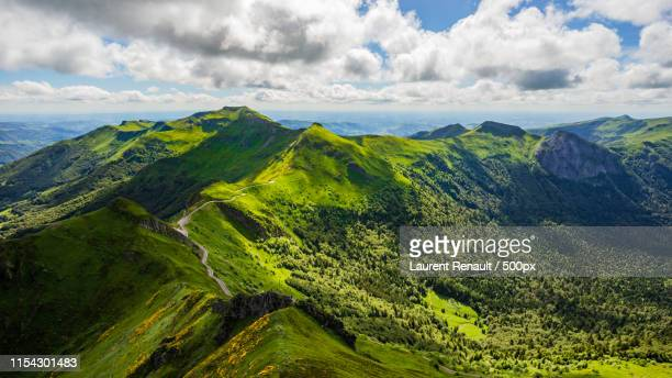 panoramic landscape of volcanic mountains - cantal stock pictures, royalty-free photos & images
