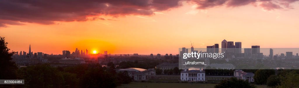 Panoramic London skyline with the Shard London Bridge, City of London and Canary Wharf at sunset : Stock Photo