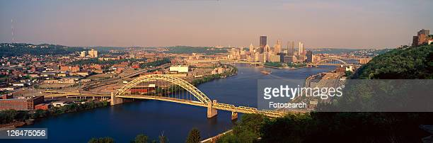 panoramic morning view of pittsburgh, pa with west end bridge, and allegheny, monongahela and ohio rivers - east stock pictures, royalty-free photos & images