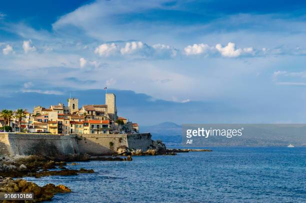 panoramic of antibes from the peninsula of le cap., french riviera, france - antibes stock photos and pictures
