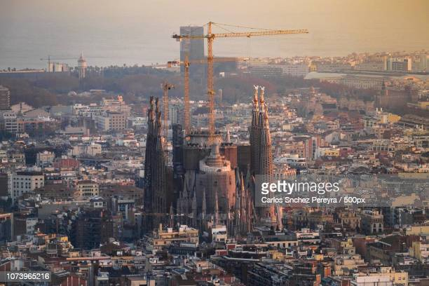 panoramic of barcelona and sagrada familia from turo de la rovira mountain, catalonia, spain - familia stock pictures, royalty-free photos & images
