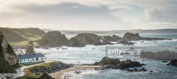panoramic of beach at ballintoy, northern ireland on a stormy day - county antrim stock pictures, royalty-free photos & images