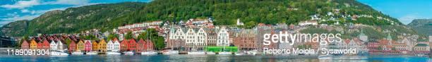 panoramic of bryggen old buildings, bergen, western fjords, norway - ウォーターフロント ストックフォトと画像
