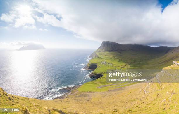 panoramic of gasadalur, faroe islands - north stock pictures, royalty-free photos & images
