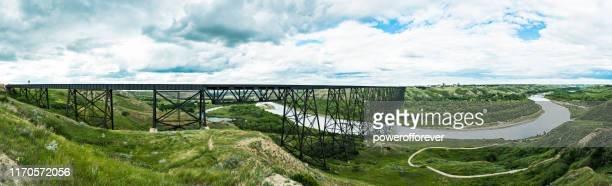 panoramic of high level bridge in lethbridge, alberta, canada - powerofforever stock pictures, royalty-free photos & images