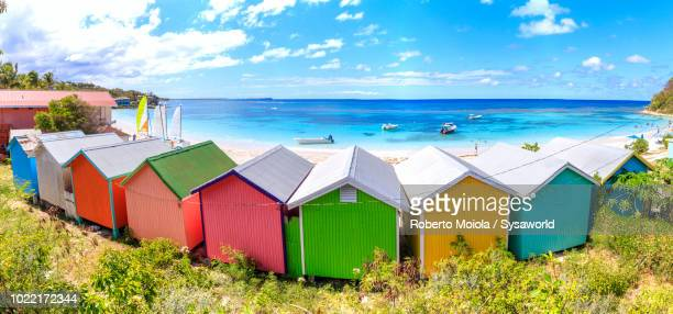 Panoramic of multi colored beach huts seafront, Long Bay, Antigua,