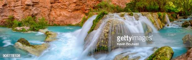 panoramic of small waterfall along havasu creek downstream from havasu falls - havasu creek stock photos and pictures