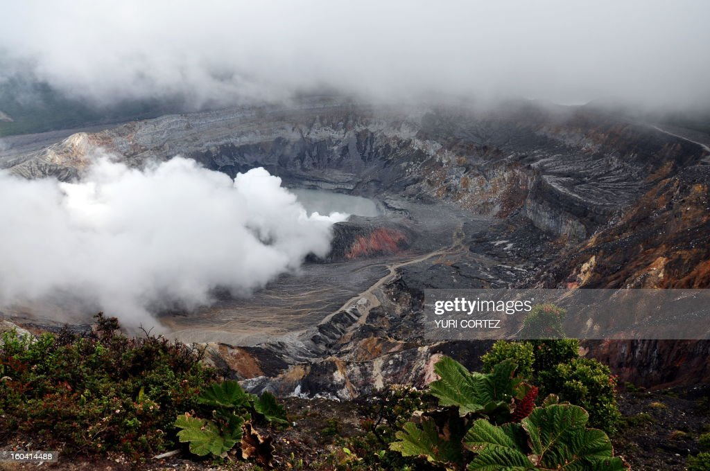 Panoramic of the crater of the Poas Volcano at the Poas Volcano National Park in Alajuela, some 40 km from San Jose on February 11, 2010. Poas Volcano is an active volcano in Costa Rica at about 2,700 meters above sea level and one of the most visited places by tourists. AFP PHOTO/Yuri CORTEZ /