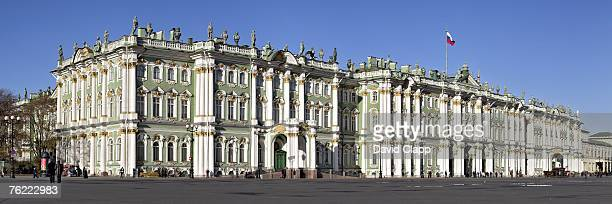 panoramic of the winter palace which houses the hermitage museum, st petersburg, russia - winter palace st. petersburg stock photos and pictures