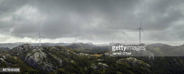 Panoramic of wind farm on cliff top and dramatic sky