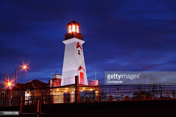 panoramic photo of a lighthouse at night - mississauga stock pictures, royalty-free photos & images