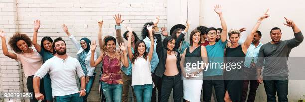 panoramic photo of multi ethnic group of adults - work party stock pictures, royalty-free photos & images