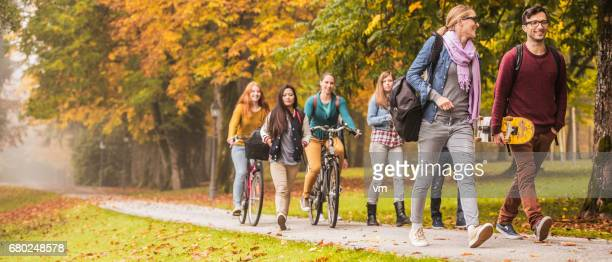 panoramic photo of students walking through the park - high school musical: the musical: the series stock pictures, royalty-free photos & images