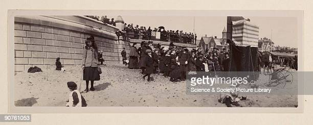 A panoramic photograph of the beach and promenade at Lowestoft taken by George Davison [18541930] in about 1905 A few children play in the foreground...