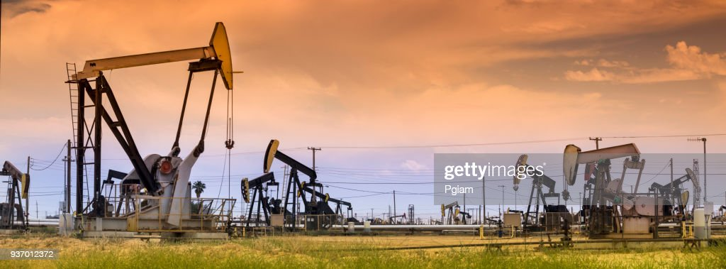 Panoramic pumpjack lifts oil from a well in California : Stock Photo
