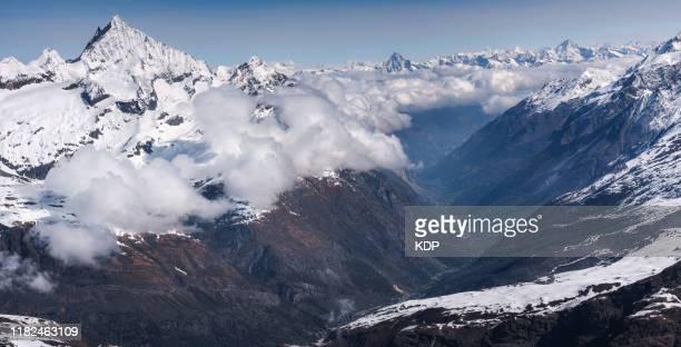 panoramic scenery view of mountain alpine at matterhorn glacier paradise peak, zermatt, switzerland. landscape panorama scenic of swiss alps and zermatt city valley - pinnacle peak stock pictures, royalty-free photos & images