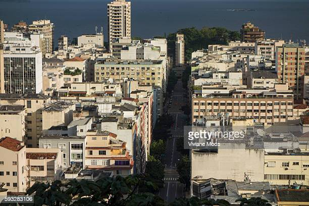 Panoramic scenes from the favela Cantagalo looking down onto Copacabana and Ipanema and the ocean beyond The wealthy and the rich