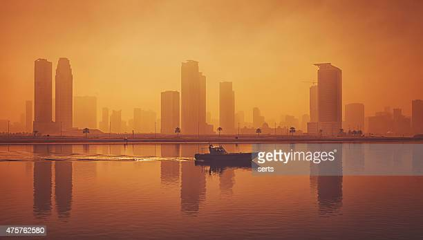 Panoramic sea tranquility and city silhouette view of in Dubai