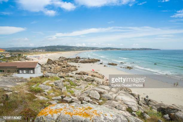 panoramic shot of a lanzada beach, rias baixas, pontevedra, spain - pontevedra province stock photos and pictures